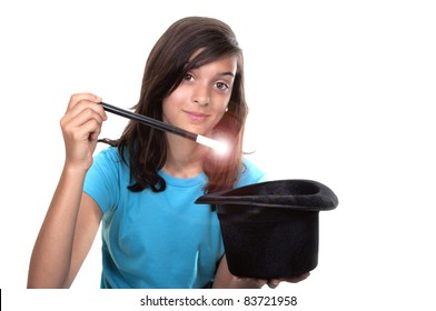 teenage girl with magic wand and hat on white background