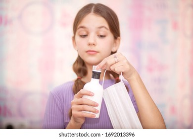 Teenage girl makes creative content for followers on social network. Use sanitizer, face masks! Good hygiene to fight coronavirus. Trendy youth lifestyle of generation zed reacts to Covid-19 pandemics - Shutterstock ID 1692013396