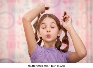 Teenage girl makes creative content for her friends and followers on social network. Smiling laughing teenager with closed eyes holds her hair. Trendy youth lifestyle of generation zed. - Shutterstock ID 1694456701