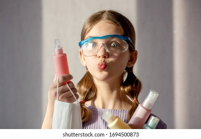 Teenage girl makes creative content for followers on social network. Use soap, face masks for good hygiene to fight coronavirus epidemics. Trendy youth lifestyle of generation zed reacts on pandemic. - Shutterstock ID 1694500873