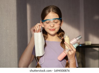 Teenage girl makes creative content for followers on social network. Use soap, face masks for good hygiene to fight coronavirus epidemics. Trendy youth lifestyle of generation zed reacts on pandemic. - Shutterstock ID 1694500876