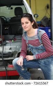 Teenage girl in mechanical professional training