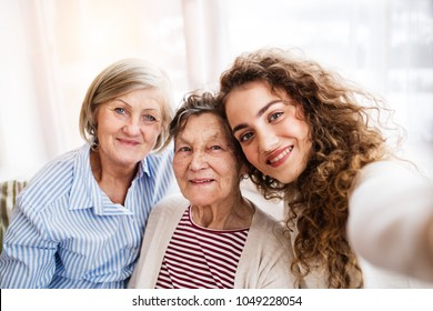 A teenage girl with mother and grandmother at home.