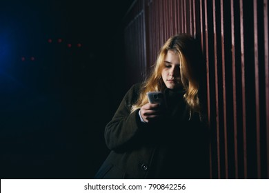 A teenage girl at night on the street. Is a harassment online