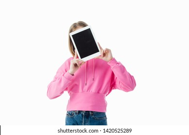 teenage girl with obscure face holding digital tablet with blank screen isolated on white