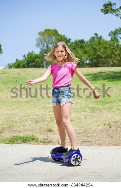 Teenage girl on blue hover-board