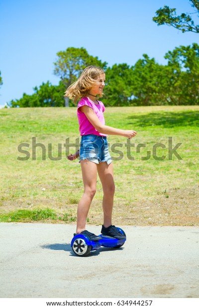 Teenage girl on blue hover-board