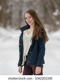 Teenage girl on a snowy path