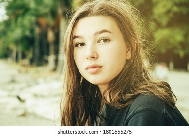 Teenage girl outdoors at sunset close-up face