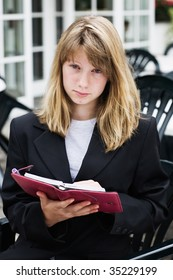 Teenage girl with personal organizer