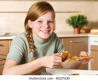 Teenage girl with pizza