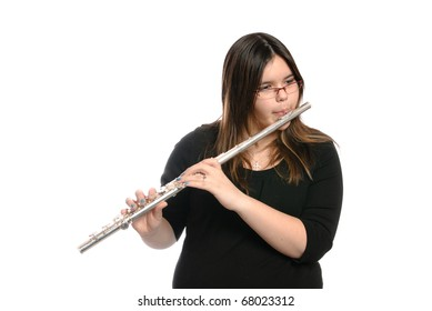 A teenage girl is playing the flute, isolated against a white background.