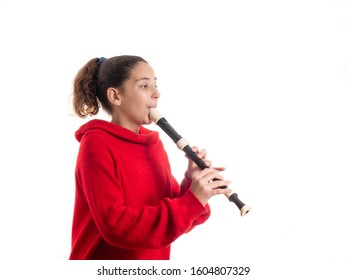 teenage girl playing the flute or recorder isolated on white background