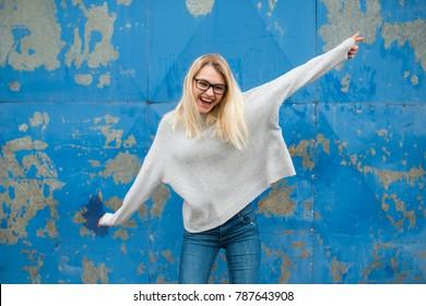 Teenage girl posing and having fun, party life, wearing glasses