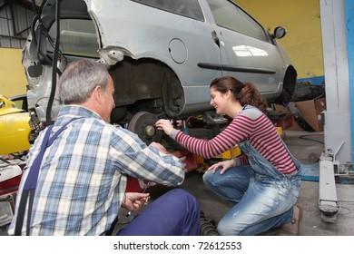 Teenage girl in professional training in workshop