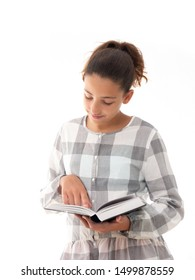 teenage girl reading a book isolated on white background