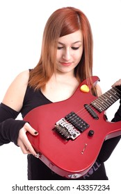 Teenage girl with a red electric guitar on white background