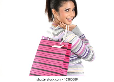 Teenage girl returning from shopping with bags