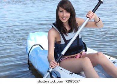 Teenage girl in row boat