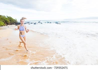 Teenage girl running on the beach