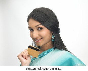 Teenage girl with sari holding the credit-card