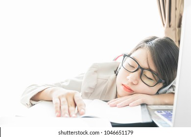 Teenage girl short hair sleep on desk after working on laptop while sit near window at home office