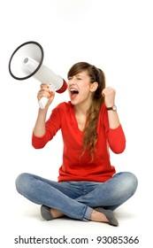 Teenage girl shouting through megaphone