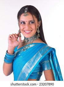 Teenage girl showing her earrings