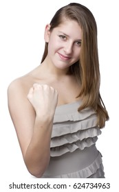 teenage girl shows a fist on white background