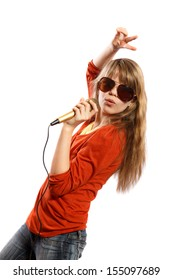Teenage girl singing into a microphone on a white background