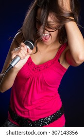 Teenage girl singing with microphone