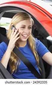 Teenage Girl Sitting In Car Talking On Cellphone