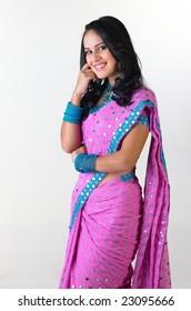 Teenage girl smiling in pink sari