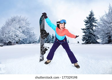 a teenage girl snowboarding in the Alps.