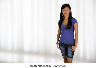 Teenage girl standing up in her home