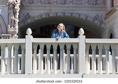 Teenage girl standing outside on bridge