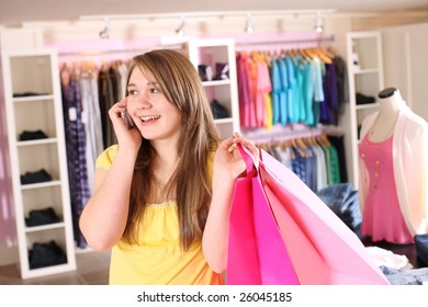 Teenage girl at store talking on cell phone