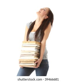 Teenage girl struggling with stack of books isolated