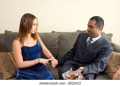 Teenage girl telling man that he is definitely late.