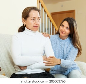 Teenage girl tries reconcile with  mother in home. Focus on mature