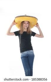teenage girl trying on a yellow sombrero