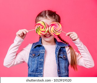 Teenage girl with two lollipops