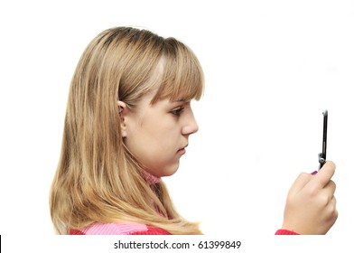 teenage girl typing sms on the mobile phone over the white