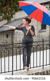 Teenage girl with umbrella waiting for rain