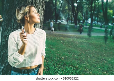 Teenage girl using electronic cigarette