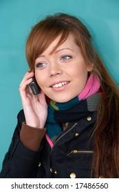 Teenage girl using mobile phone, exterior