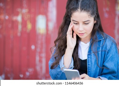 Teenage Girl Victim Of Bullying By Text Message Outdoors