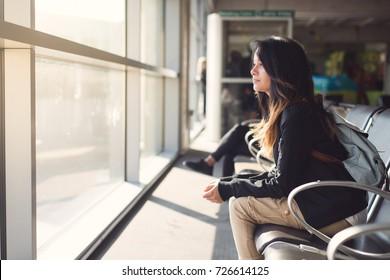 Teenage girl waiting in airport lounge