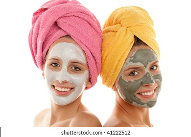 Teenage girl wearing facial masks isolated on white background