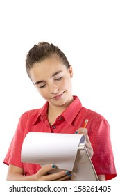 teenage girl writing on a pad, isolated on white.